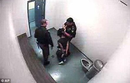 Teen punched and kicked in custody